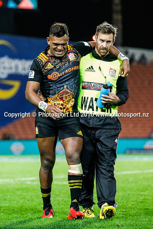 Chiefs centre Seta Tamanivalu leaves the field with a foot injury during the Super Rugby match - Chiefs v Rebels played at FMG Stadium Waikato, Hamilton, New Zealand on Saturday 21 May 2016. <br /> <br /> Copyright Photo: Bruce Lim / www.photosport.nz