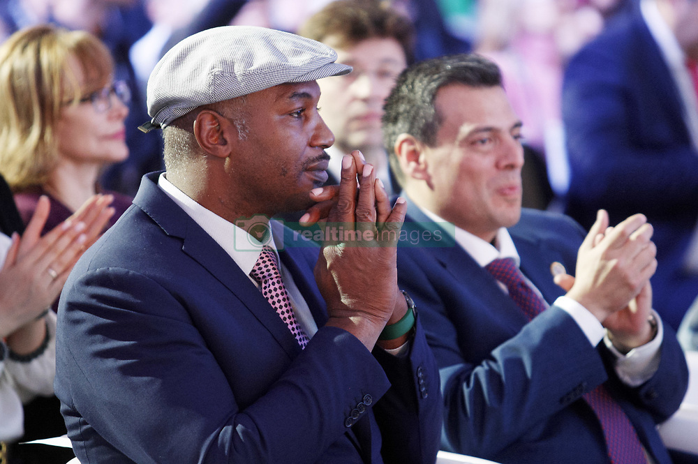 October 1, 2018 - Kiev, Ukraine - Ex boxing champion Lennox Lewis and WBC President Mauricio Sulaiman attend an official opening of the 56th WBC ( World Boxing Council ) Convention in Kiev, Ukraine, 01 October, 2018. The 56th WBC Convention takes place in Kiev from September 30 to October 05. The event participate of boxing legends Lennox Lewis, Evander Holyfield, Eric Morales, Alexander Usik, Vitali Klitschko and about 700 congress participants from 160 countries. (Credit Image: © Str/NurPhoto/ZUMA Press)