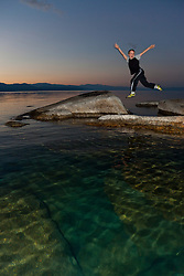 """Boy at Lake Tahoe 3"" - This boy was photographed near Speedboat Beach, Lake Tahoe,  jumping from rock to rock at sunrise."
