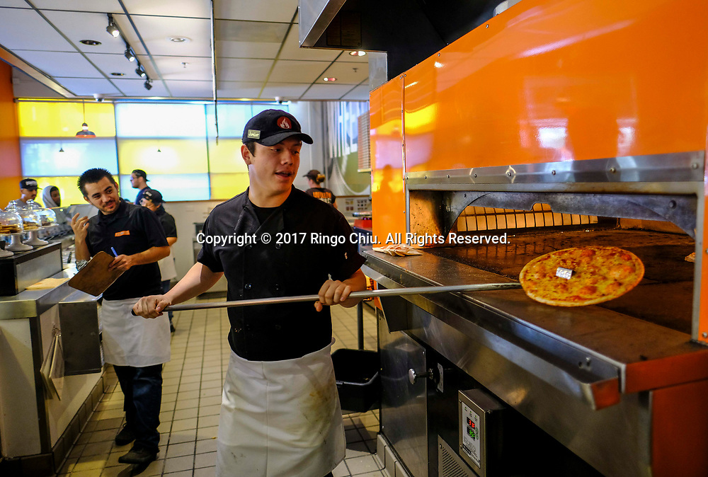 Worker of Blaze Pizza in Pasadena. (Photo by Ringo Chiu)<br /> <br /> Usage Notes: This content is intended for editorial use only. For other uses, additional clearances may be required.