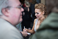 © Licensed to London News Pictures . 16/05/2015 .  The Palace Hotel , Manchester , UK . Stephanie Waring off of Hollyoaks signing autographs on Oxford Road . Traffic is halted in all directions at the junction of Oxford Road and Whitworth Street West as soap stars cross from the Palace Hotel to the Palace Theatre . The 2015 British Soap Awards , The Palace Hotel , Oxford Road , Manchester . Photo credit : Joel Goodman/LNP
