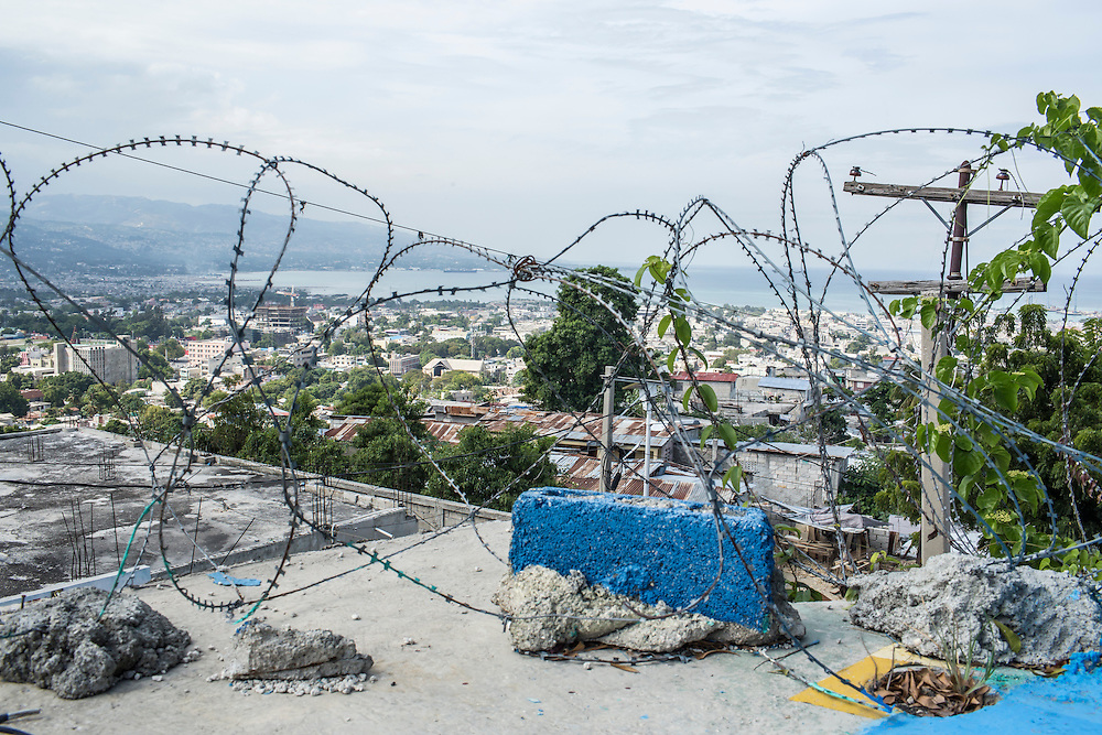 Barbed wire rings the base of UN peacekeeping troops, operating under the auspices of MINUSTAH, in the Fort National neighborhood on Tuesday, December 16, 2014 in Port-au-Prince, Haiti. The UN has a controversial record in Haiti, and is extremely unpopular.