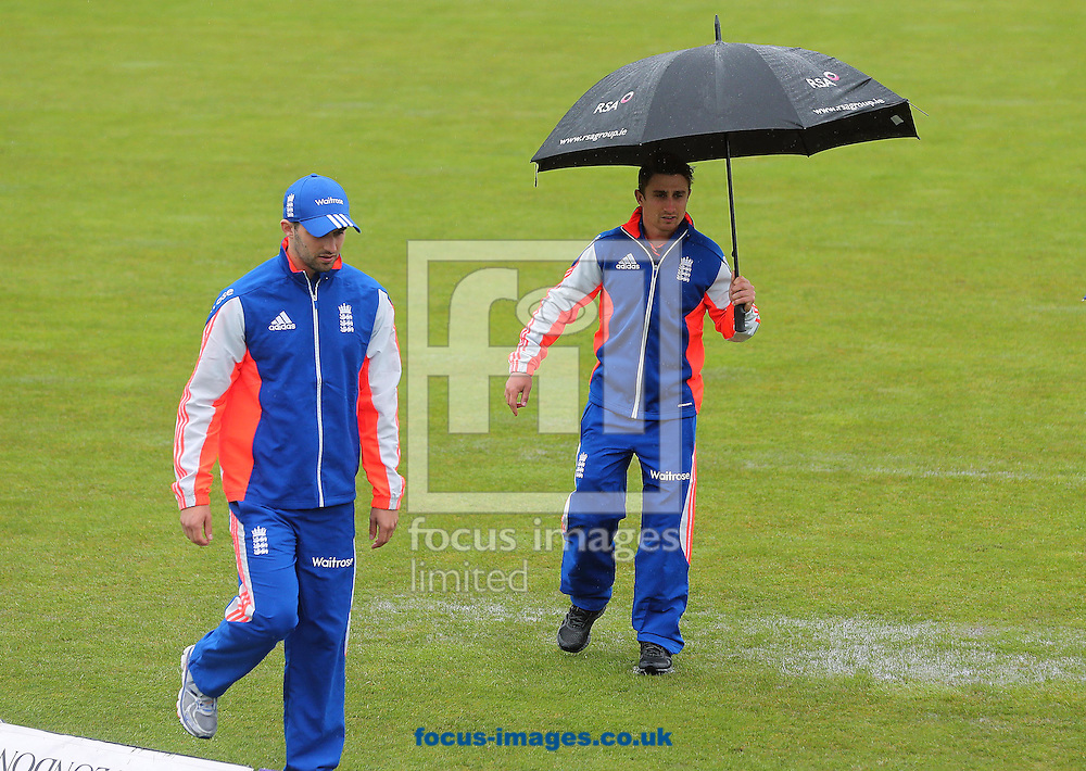 Mark Wood and James Taylor make their way across the pitch after the the One Day International match at the Village, Malahide was abandoned due to bad weather<br /> Picture by Lorraine O'Sullivan/Focus Images Ltd +353 872341584<br /> 08/05/2015