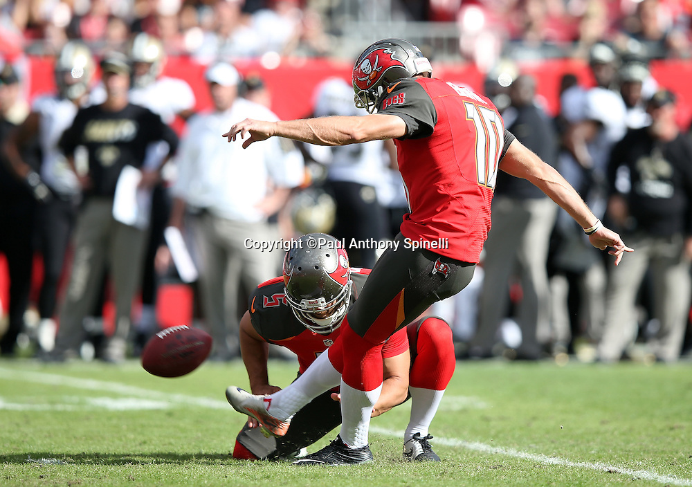 Tampa Bay Buccaneers punter Jacob Schum (5) holds while Tampa Bay Buccaneers kicker Connor Barth (10) kicks a 39 yard late second quarter field goal that cuts the New Orleans Saints lead to 17-10 during the 2015 week 14 regular season NFL football game against the New Orleans Saints on Sunday, Dec. 13, 2015 in Tampa, Fla. The Saints won the game 24-17. (©Paul Anthony Spinelli)