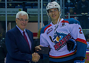 KELOWNA, CANADA - JANUARY 10:  Bruce Hamilton presents Cal Foote #25 of the Kelowna Rockets a Hugo Boss suit after returning from the World Junior Tournament with a gold medal at the Kelowna Rockets game on January 10, 2018 at Prospera Place in Kelowna, British Columbia, Canada.  (Photo By Cindy Rogers/Nyasa Photography,  *** Local Caption ***
