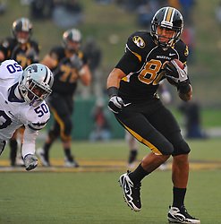 Nov 13, 2010; Columbia, MO, USA; Missouri Tigers tight end Michael Egnew (82) catches the pass and runs for yardage in the second half as Kansas State Wildcats linebacker Tre Walker (50) attempts coverage at Memorial Stadium. Missouri won 38-28. Mandatory Credit: Denny Medley-US PRESSWIRE