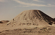 Royal Burial Mounds of A'ali, photograph, in the Bahrain National Museum, designed by Krohn and Hartvig Rasmussen, inaugurated December 1988 by Amir Shaikh Isa Bin Salman Al-Khalifa, in Manama, Bahrain. This is a royal cemetery built for the Dilmun kings outside their capital Qal'at al-Bahrain, with 14 mounds built along a ceremonial route. The Bahrain National Museum houses cultural and archaeological collections covering 6000 years of history, with rooms entitled Burial Mounds, Dilmun, Tylos and Islam, Customs and Traditions, Traditional Trades and Crafts, and Documents and Manuscripts. Picture by Manuel Cohen