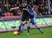 Andy Cannon, Yanic Wilshut during the Sky Bet League 1 match between Rochdale and Wigan Athletic at Spotland, Rochdale, England on 14 November 2015. Photo by Daniel Youngs.
