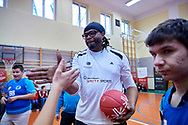 Warsaw, Poland - 2018 November 22: Samuel Perkins (American retired professional NBA basketball player) with disability children play basketball while training session during Special Olympics European Basketball Week 2018 at Eunice Kennedy School  on November 22, 2018 in Warsaw, Poland.<br /> <br /> Adam Nurkiewicz declares that he has no rights to the image of people at the photographs of his authorship.<br /> <br /> Picture also available in RAW (NEF) or TIFF format on special request.<br /> <br /> Any editorial, commercial or promotional use requires written permission from the author of image.<br /> <br /> Image can be used in the press when the method of use and the signature does not hurt people on the picture.<br /> <br /> Mandatory credit:<br /> Photo by © Adam Nurkiewicz