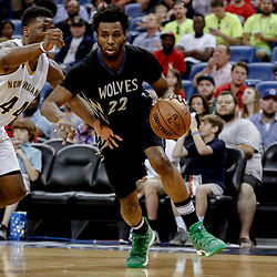 Mar 19, 2017; New Orleans, LA, USA; Minnesota Timberwolves forward Andrew Wiggins (22) drives past New Orleans Pelicans forward Solomon Hill (44) during the first quarter of a game at the Smoothie King Center. Mandatory Credit: Derick E. Hingle-USA TODAY Sports