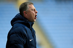 Coventry City manager Mark Robins gestures on the touchline