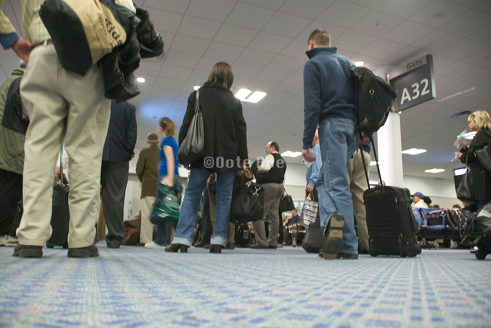 low angle view of passengers waiting to board an airplane