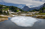 Partially thawed tarn, Yellow Aster Butte Basin, Mount Baker Wilderness, North Cascades Washington
