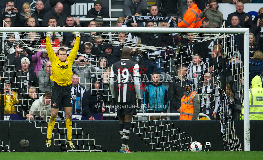 NEWCASTLE, ENGLAND - Sunday, March 4, 2012: Sunderland's goalkeeper Simon Mignolet prepares to save a penalty from Newcastle United's Demba Ba during the Premiership match at St. James' Park. (Pic by David Rawcliffe/Propaganda)