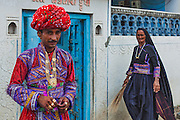 A gujarati groom of Maldhari community standing outside his home before his wedding.