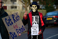 © Licensed to London News Pictures. 22/12/2016. London, UK. A No Heathrow 3rd Runway campaigner holds up a sign outside Ealing Magistrates Court in London, to show support for 15 protestors who are charged with Wilful Obstruction of the Highway after blocking an access road to Heathrow on November 18, 2016. Photo credit: Ben Cawthra/LNP