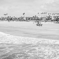 Seal Beach California coastline panorama black and white photo with the Pacific Ocean, lifeguard tower, and oceanfront homes. Seal Beach is in Orange County Southern California in the United States of America. Panoramic photo ratio is 1:3.