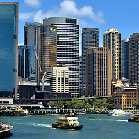 Ferries Leaving Circular Quay in Sydney, Australia<br /> In 1789, a ferry service was established in Sydney. The first convict-built ship was nicknamed &ldquo;The Lump.&rdquo; This humble beginning led to the formation of Sydney Ferries Limited 110 years later. The company was the world&rsquo;s largest ferry fleet until 1932 when it declined after the Sydney Harbour Bridge opened. In 1951, the government of New South Wales purchased the transport operation. Seen leaving the Circular Quay Station are the Alexander and Charlotte. Both are First Fleet class ferries launched in 1985.