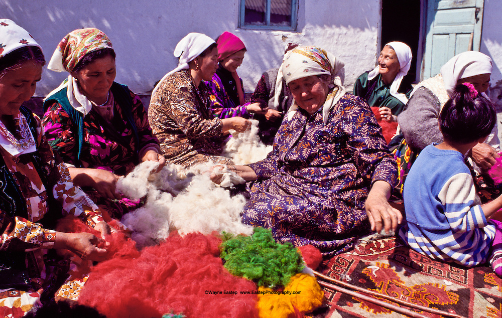 Village ladies work together to make fine felt in Shieli in the Qizilorda regiion, Kazakhstan