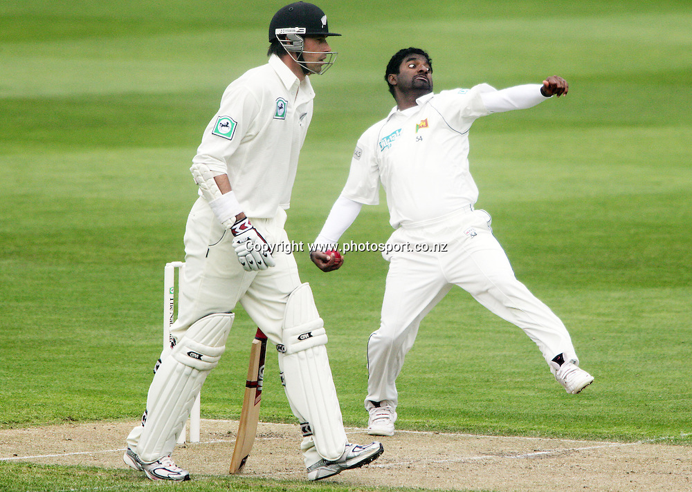 Muttiah Muralitharan bowls past Stephen Fleming on day one of the first cricket test match between the New Zealand Black Caps and Sri Lanka at Jade Stadium, Christchurch, New Zealand on Thursday 7 December 2006. The Black Caps bowled Sri Lanka out for 154 runs and are 85/2 at the end of play on day one. Photo: Hannah Johnston/PHOTOSPORT<br />