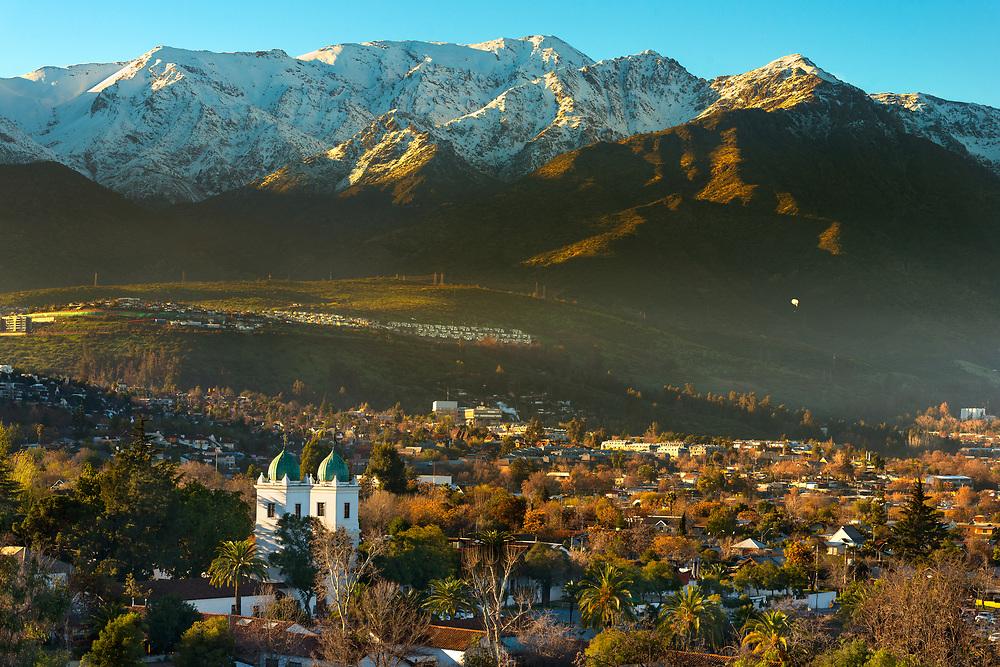 View of Los Dominicos neighborhood and Los Dominicos church with Los Andes Mountain Range as a backdrop, Las Condes district, Santiago de Chile