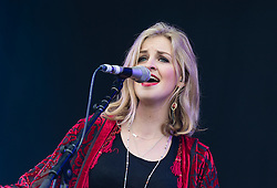 © Licensed to London News Pictures. 13/06/2015. Newport, UK.   Ward Thomas performing live at Isle of Wight Festival 2015, Day 3 Saturday. In this picture - Lizzy Ward Thomas. This afternoon as started with warm sunshine.  Yesterday the rain was torrential.  Headline acts include The Prodigy, Blur and Fleetwood Mac.   Photo credit : Richard Isaac/LNP