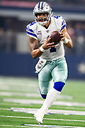 ARLINGTON, TX - OCTOBER 14:  Dak Prescott #4 of the Dallas Cowboys fumbles the football, then picks it up and runs in the first half of a game against the Jacksonville Jaguars at AT&T Stadium on October 14, 2018 in Arlington, Texas.  The Cowboys defeated the Jaguars 40-7.  (Photo by Wesley Hitt/Getty Images) *** Local Caption *** Dak Prescott