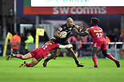 Olly Woodburn of Exeter Chiefs is tackled by James Lang of Harlequins and Gabriel Ibotoye of Harlequins during the Aviva Premiership match between Exeter Chiefs and Harlequins at Sandy Park, Exeter, United Kingdom on 19 November 2017. Photo by Graham Hunt.