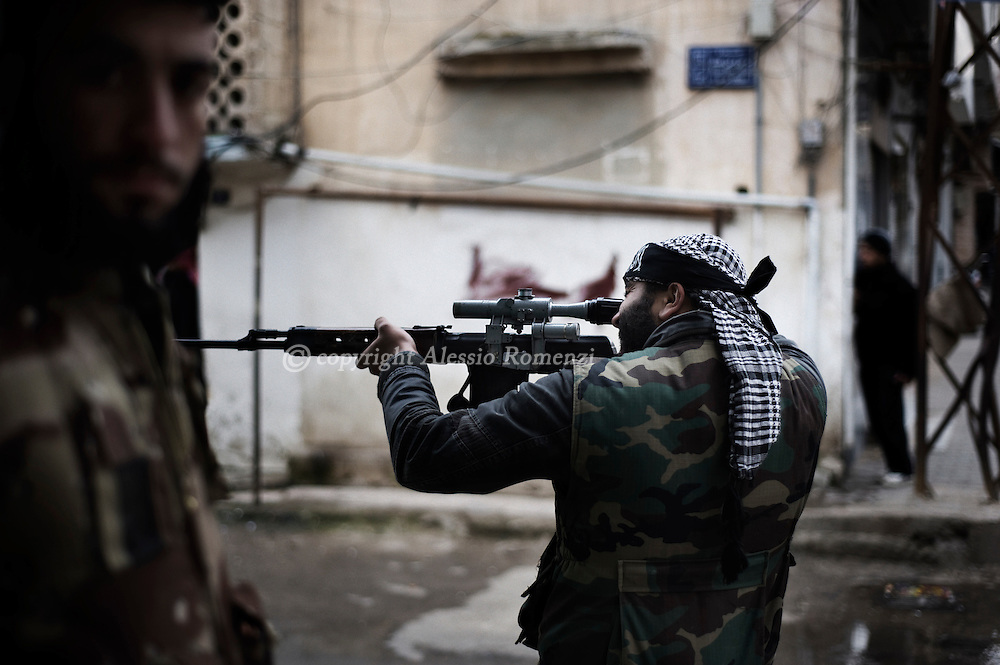 SYRIA - Al Qsair. Free Syrian Army fighter is seen as he aims an Al Asad Forces position in Al Qsair, on February 24, 2012. ALESSIO ROMENZI