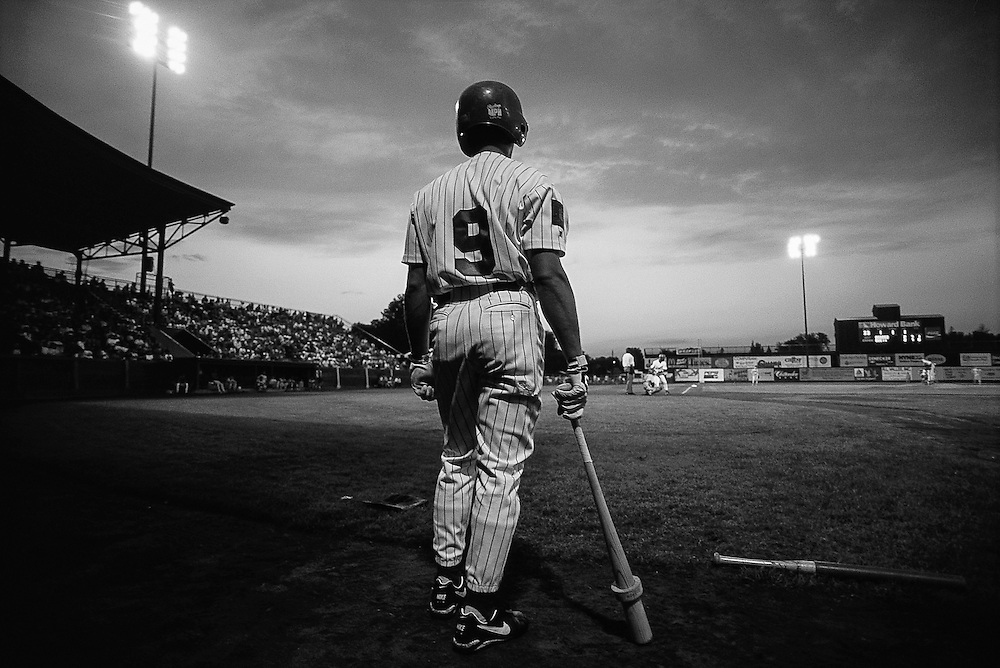 July 1995, Burlington, Vermont, USA --- Baseball Player Watching Game --- Image by © Christopher J. Morris/CORBIS