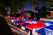 View of the Night Market, Luang Prabang, Laos, with Wat Ho Pha Bang in the background.