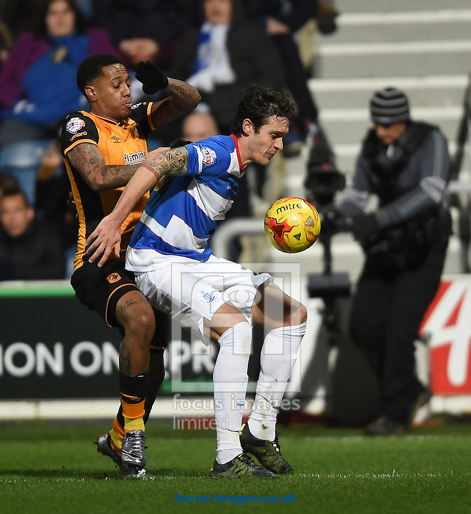 Queens Park Rangers' Andrew Robertson (right) and Hull City's Abel Hernandez during the Sky Bet Championship match at the Loftus Road Stadium, London<br /> Picture by Daniel Hambury/Focus Images Ltd +44 7813 022858<br /> 01/01/2016