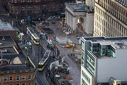© Licensed to London News Pictures . 07/12/2013 . Building and construction work in St Peters Square in front of the Town Hall and Central Library , as trams pass through . Cityscape view of Manchester . Photo credit : Joel Goodman/LNP