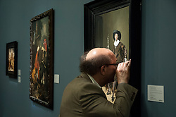 © Licensed to London News Pictures. 06/07/2015. London, UK.  A visitor makes a close inspection of a painting at the preview of Old Masters, British Paintings and Masterworks from the collection of Castle Howard at Sotheby's ahead of the auction on July 8. Photo credit : Stephen Chung/LNP