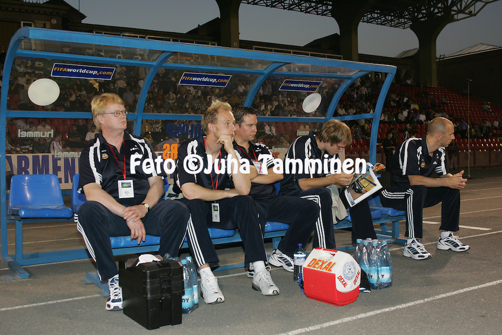 08.09.2004, Republica Stadium, Erevan, Armenia..FIFA World Cup 2006 Qualifying Match, .Armenia v Finland.Watching the warm up on the Finland bench, from left: doctor Heikki Kinnunen, Peter Enckelman, masseur Hannu Kanerva, Markus Heikkinen and physio Paavo Leiramo.