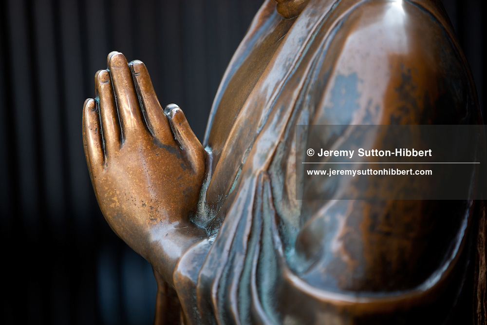 Buddhist statue, with hands in prayer, at Senso-ji temple in Asakusa district of Tokyo, Japan, Monday 7th November 2011.