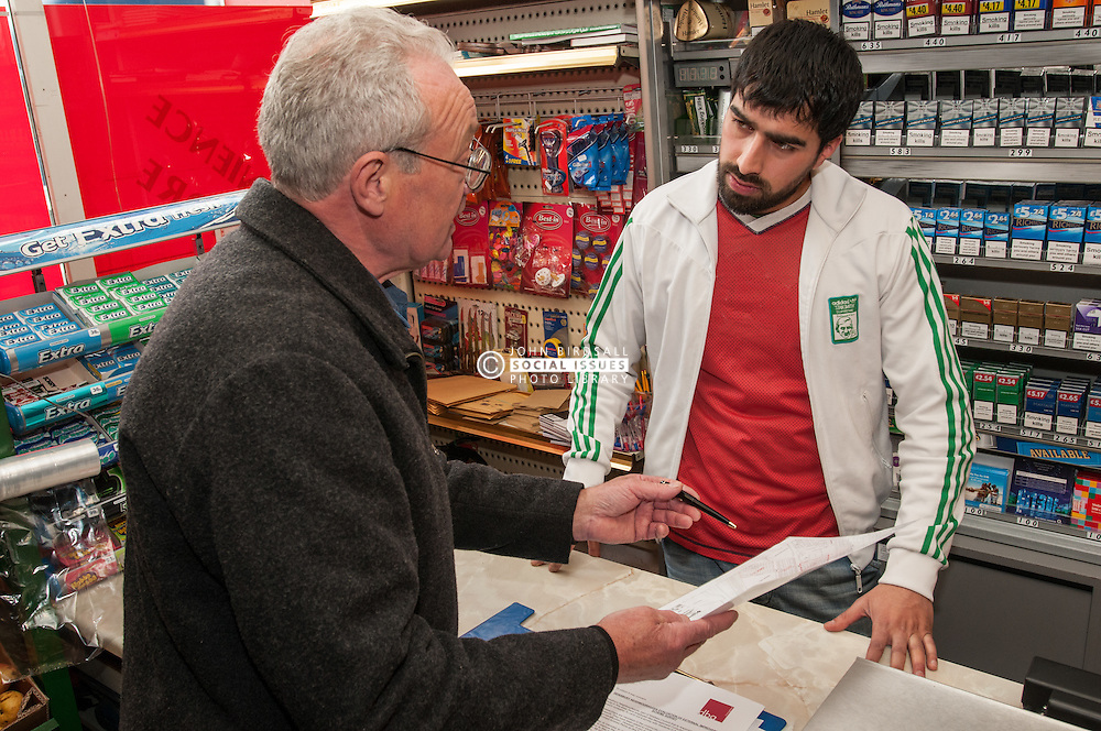 Community worker talking to a local shop keeper