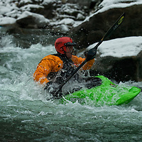 Winter kayaking on the south fork of the Payette River near Banks, Idaho.