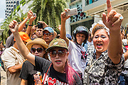 "25 MAY 2014 - BANGKOK, THAILAND: Thai ""Red Shirt"" supporters of the ousted civilian government at a demonstration against the military junta. Public opposition to the military coup in Thailand grew Sunday with thousands of protestors gathering at locations throughout Bangkok to call for a return of civilian rule and end to the military junta.     PHOTO BY JACK KURTZ"