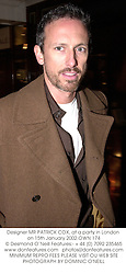Designer MR PATRICK COX, at a party in London on 15th January 2002.OWN 174