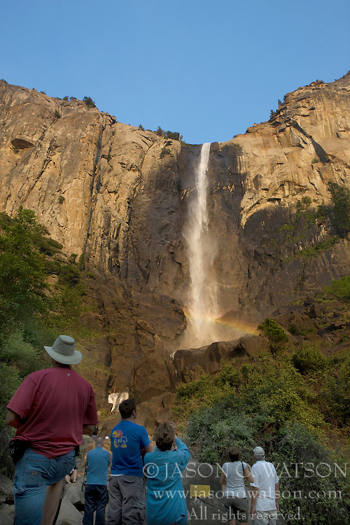 Tourists gaze at Bridalveil Fall, Yosemite National Park, California, USA.