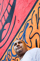 "2 August, 2008. New York, NY. Angel Ortiz, 41, a graffiti artist who collaborated with Keith Haring in the 80's, is here in front of the mural he tagged on July 22nd 2008. Angel Ortiz tagged his nickname ""LA2"", which refers to ""Little Angel"", on the Keith Haring mural that was reproduced on May 4th 2008, after the original 1982 graffiti was painted over. Angel Ortiz asked Clayton Patterson, an artist and gallerist, to help him tag the wall with his own artwork. Mr. Ortiz has accused the Haring Foundation of denying him credit on many of the jointly produced works.  The two artists met in 1980, when Angel Ortiz was 13 years old. Subsequently, Ortiz and Haring collaborated for several years and had joint shows. <br />  ©2008 Gianni Cipriano for The New York Times<br /> cell. +1 646 465 2168 (USA)<br /> cell. +1 328 567 7923 (Italy)<br /> gianni@giannicipriano.com<br /> www.giannicipriano.com"