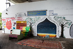 London, UK. 13 June, 2019. Murals and a prayer space underneath the Westway close to the Grenfell Tower in North Kensington. Tomorrow, the Grenfell community will mark the second anniversary of the Grenfell Tower fire on 14th June 2017 in which 72 people died and over 70 were injured. Two years on, some family members remain in temporary accommodation and many are still traumatised. Phase 2 of the Grenfell Inquiry will begin in 2020, with criminal investigation findings expected to be sent to the Crown Prosecution Service in 2021.