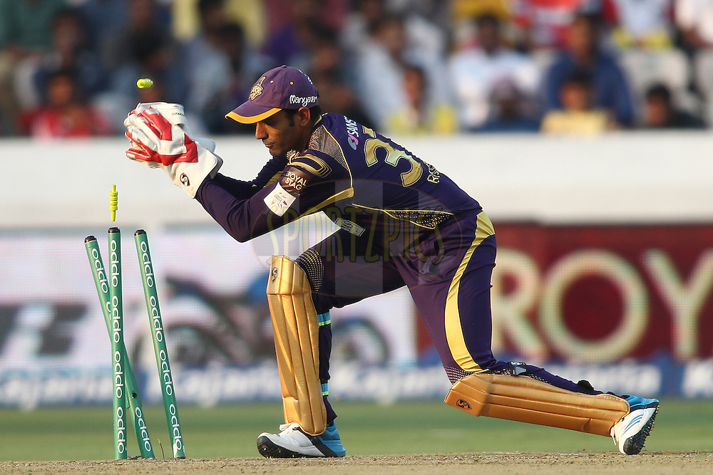 Robin Uthappa of the Kolkata Knight Riders breaks the stumps to run out Evan Gulbis of the Hobart Hurricanes during the first semi final match of the Oppo Champions League Twenty20 between the Kolkata Knight Riders and the Hobart Hurricanes held at the Rajiv Gandhi Cricket Stadium, Hyderabad, India on the 2nd October 2014<br /> <br /> Photo by:  Shaun Roy / Sportzpics/ CLT20<br /> <br /> <br /> Image use is subject to the terms and conditions as laid out by the BCCI/ CLT20.  The terms and conditions can be downloaded here:<br /> <br /> http://sportzpics.photoshelter.com/gallery/CLT20-Image-Terms-and-Conditions-2014/G0000IfNJn535VPU/C0000QhhKadWcjYs