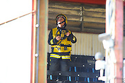 Main stand evacuated - Fireman in the main stand checking for hotspots after smoke was spotted during the Sky Bet League 2 match between Exeter City and Carlisle United at St James' Park, Exeter, England on 12 March 2016. Photo by Graham Hunt.