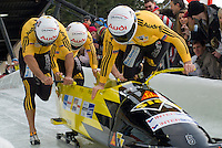 The Swiss team of Ivo Rueegg, Roman Handschin, Cedric Grand and Patrick Bloechliger compete in the Mens' four-person bobsleigh World Cup competition held at the Whistler Sliding Centre on Feb 7, 2009