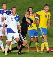 13.8.2013, Kaurialan stadion, Hämeenlinna, Finland.<br /> Alle 19-vuotiaiden maaottelu Suomi - Englanti / U-19 Friendly International match, Finland v Sweden.<br /> Joel Mero, Alex Lehtinen & Ville Viljala (Finland) v Henrik Carlsson (18 - Sweden).