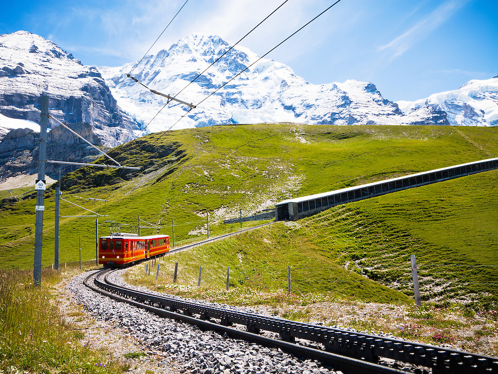 The Jungfraubahn train which transports tourists to Jungfraujoch railway station, highest railway station in Europe (3,454 meters), from Kleine Scheidegg and the town of Grindelwald below. It's located near Mount Eiger, Monch and Jungfrau in the Bernese Alps.