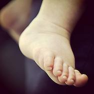 Roslyn, NY: June 15, 2013---  Tiny sweet baby feet. © Audrey C. Tiernan Photography, Inc.