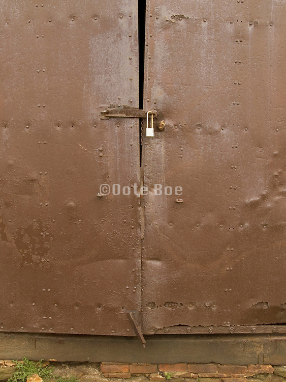 old metal door locked with a padlock
